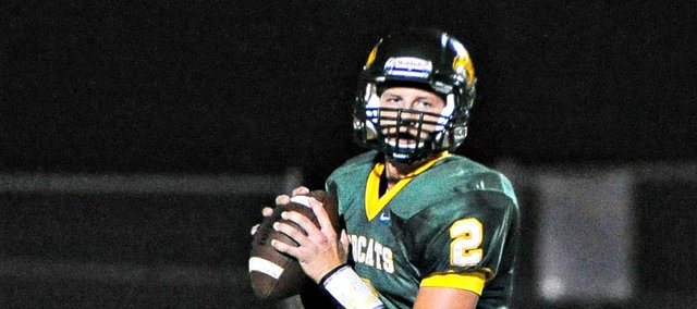 Tim Sanders threw for 203 yards and four touchdowns, but Basehor-Linwood fell to Jeff West on Friday in overtime, 36-35.