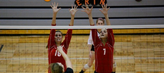 Cheyenne Ford, left, and Jessica Minear go up for a block against Bonner Springs' Mikaela Bennet. Minear had a team-high 15 kills, but Tonganoxie lost to the Braves in five sets.