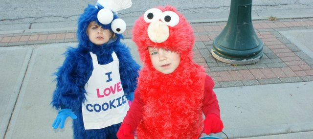Lilly Bedtke, 3 (Cookie Monster), and Rylan Bedtke, 4 (Elmo), at Spooktacular on Friday, Oct. 26, 2012, in downtown Tonganoxie.