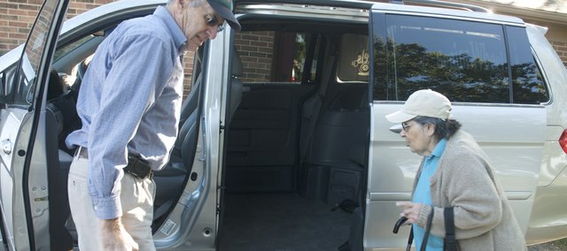 Roger White opens the door Friday to Senior Wheels' new Honda van for Lorettamay Davis, who was getting a ride from Hancuff Place to an appointment at Neu Therapy.