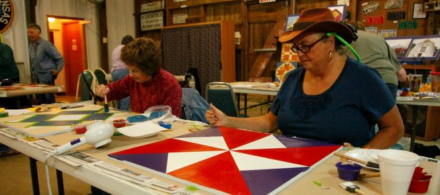 Jean Pearson and Meri O'Hare work on barn quilt blocks Saturday, Oc. 26, at the Tonganoxie Community Historic Site.