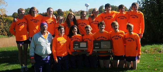 The Baldwin High School girls and boys cross country teams pose after the boys won and the girls were runner up at the 4A state cross country championship Saturday at Wamego.