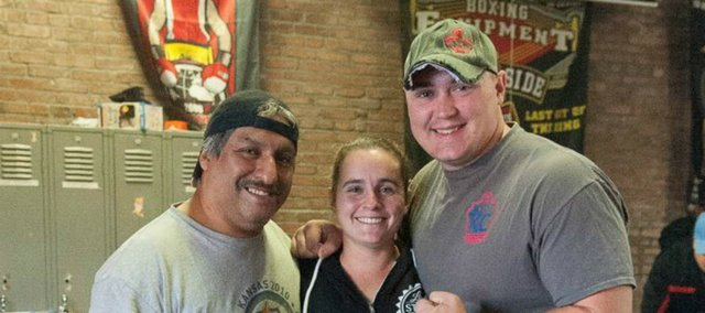 Stella, center, and Chris Ridihalgh, right, competed in the Kansas City Guns 'N Hoses charity boxing event Saturday in Kansas City, Mo.