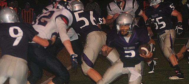 Senior Cornell Brown, 2, jukes through the St. James Academy line during Tuesday's playoff game. Brown scored all three touchdowns for the Bulldogs as they won the game, 19-0.