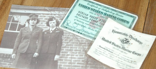 Miriam Krum of Bonner Springs has only a few souvenirs of her days in the Marine Corps Women's Reserve during World War II. Above is a photo of Krum (left) and her sister, Ethel Wood, in uniform. Wood served in the Navy. At right are Krum's honorable discharge papers.