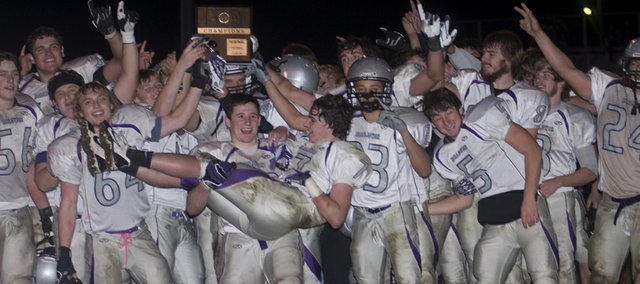 The Baldwin Bulldog football celebrate after its 28-10 district football victory Saturday against Tonganoxie,