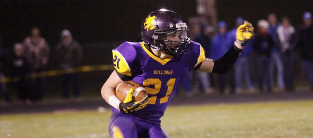 Drew Cerny ran for 148 yards and a touchdown, but McLouth High dropped its playoff opener to Troy on Friday, 26-14.