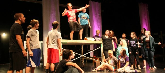 "Tonganoxie High School students Monday rehearse a scene from the musical ""Pippin,"" which the THS drama and music departments will perform Thursday through Sunday at the Tonganoxie Performing Arts Center."