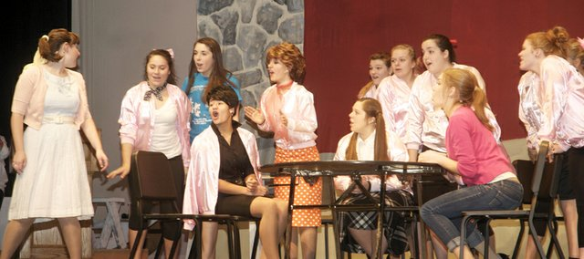 "Senior Madeline Miley as Sandy sings about her summer romance to the girls of Rydell High School, including Pink Lady club members, in a scene from Baldwin High School's fall musical ""Grease"""