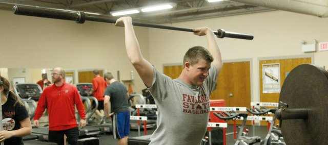 Clayton Neas works on his lifting technique at Monday's practice at Tonganoxie High. Neas is one of five returning state participants on the boys side and nine overall. The Chieftains are set to open their 2014 season Jan. 11 at McLouth.