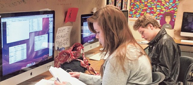 "Stevie Robrahn, left, and her brother, Clayton Robrahn, read through student submissions to Shawnee Mission North's literary and art magazine, ""Indian Lore."""