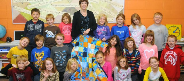 The Baldwin Elementary School Intermediate Center third-grade class of Kathy Bourgeois crafted a quilt after learning to sew. The quilt is to be sent to school children in the farming village of Riviersonderend, South Africa.