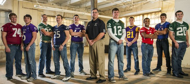 The 2013 Journal-World All-Area Football team, from left: Kyle Wittman, Lawrence; Chad Berg, Baldwin; Zach Bickling, Free State; Micah Clarke, Mill Valley; Colton Stark, Baldwin; coach Michael Berg, Baldwin; player of the year Joe Dineen, Free State; Drew Cerny, McLouth; Cole Holloway, Tonganoxie; Luke Meyer, Wellsville; Keith Loneker, Free State.