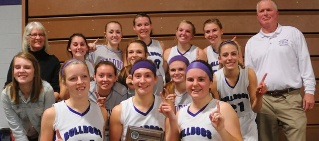 The Baldwin Bulldog girls basketball team pose Friday after claiming the Bulldog/Wildcat Classic title with a 57-35 victory against Louisburg.