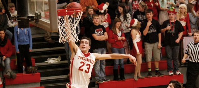 Ben Johnson throws down a dunk in Tonganoxie's 56-28 win against Anderson County. The Chieftains won't return to the court until a Jan. 7 visit from Bishop Ward.