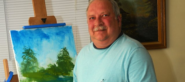 John Parkinson shows off the first painting he's completed since losing most of his vision after suffering a stroke following quadruple bypass surgery. He painted the landscape on an easel two fellow Hancuff Place residents bought for him.