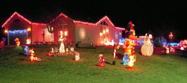 Robert Werst and Robin Lewis's display contains a mix of lights and about a dozen inflatable decorations.