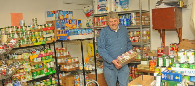 Scott Swanson restocks shelves Saturday at the Baldwin Community Food Pantry after an early morning rush. An average of from 30 to 40 people use the pantry earch week. It is open from 9 a.m. to noon each Saturday at the Baldwin First United Methodist Church, Eighth and Grove streets.