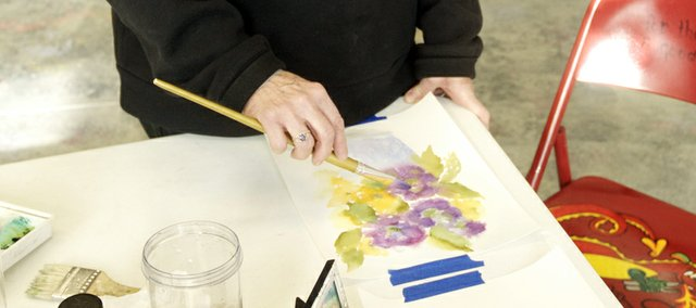 Sharron Spence of Ottawa works on a watercolor at an open studio at Thursday at the Lumberyard Arts Center. Spence will enter two of her small watercolors in the Itty Bitty Picture Show, which opens Jan. 10 at the Lumberyard.