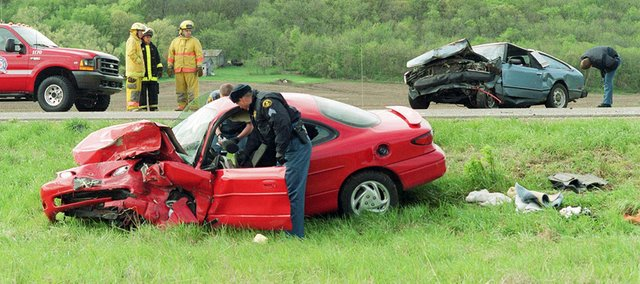 Law enforcement officers in Kansas worked the fewest number of fatal vehicle accidents, such as this one in rural Douglas County, since the Kansas Department of Transportation started keeping records. The department reported 344 fatalities, or 61 fewer than 2012.