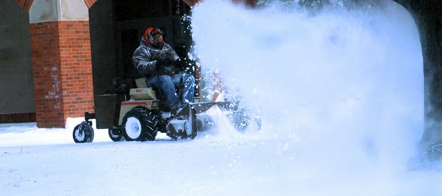 Tom Kennedy clears sidewalks Sunday at Collins Gym on the Baker University campus. Kennedy said he and others worked for 8 a.m. to noon to clear the campus sidewalks.