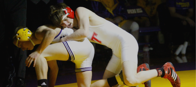 Tyler Salmon was one of seven Tonganoxie High wrestlers to pin his opponent Thursday at Spring Hill. The Chieftains won the dual with the Broncos, 52-27.