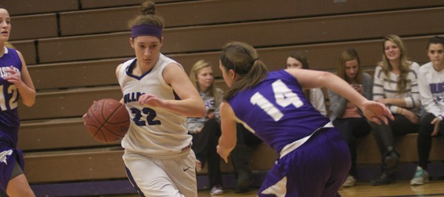 Katie Jones drives to the basket in Friday's game against Louisburg. The senior guard scored a career-high 33 points in the contest to help the Bulldogs to a 63-54 win.