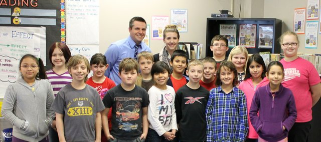 Baldwin High School graduate Colby Heckathorne was one of 32 teachers in the state to be honored with the Kansas Department of Education's Horizon Award, given to first-year teachers. Heckathorne, a fourth-grade teacher at Starside Elementary School in the De Soto school district, is pictured in the back row with her students and her principal Kasey Weishaar.