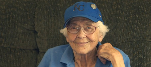 Mary Swan posed in June with a Kansas City Royal cap for a Baldwin City Signal story about her love for the team and baseball. Swan, who died Monday at the age of 92, is remembered by friends as a person who spread good cheer through easy laughter and good humor.