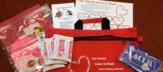 "Participants in the ""Our Family Loves to Read"" program at the Basehor, Bonner Springs, Linwood or Tonganoxie libraries will get the above bag with snacks, a craft and tips about reading together as a family, as well as a reading challenge log."