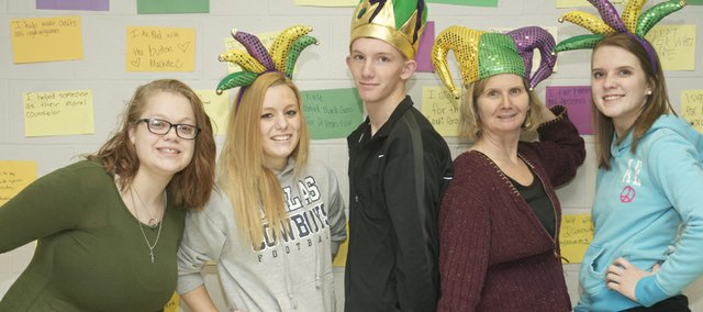 From left, Baldwin High School sophomore Kambree Judy, senior Sydney Roller, senior Austin Quick, special education teacher Laura Beaulieu and junior Molly Odgen don hats that will be worn Thursday at the school's sixth-annual Mardi Gras diversity awareness day. The event largely dependent on the efforts of the work of students will be attended by students with special needs from eight area high schools.