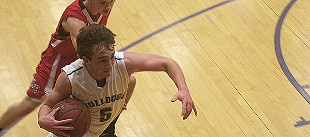 Baldwin senior guard Chad Berg drives to the basket Tuesday before passing to a teammate in the second half of the Bulldogs' 68-37 victory against Anderson County. With the first-round victory in the Baldwin Invitational Tournament, the Bulldogs will play at 8:30 p.m. Friday against Bonner Springs.