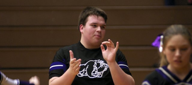 Baldwin High School sophomore Spencer Young applauds before Friday's Bulldog boys basketball game. Young is the second male to be on a BHS cheer squad, following in the footsteps of Riley Grammer, who is now a cheerleader for Kansas University.