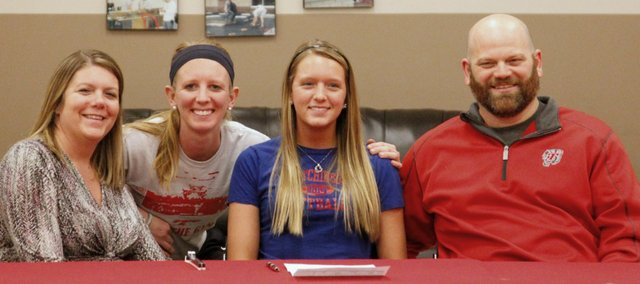 Tonganoxie High senior Caly Ingle-Maxwell, second from right, will continue her softball career next year at Hutchinson Community College.