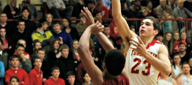 Ben Johnson hit a jump shot at the buzzer, propelling Tonganoxie High to a 63-61 win Friday against Atchison.
