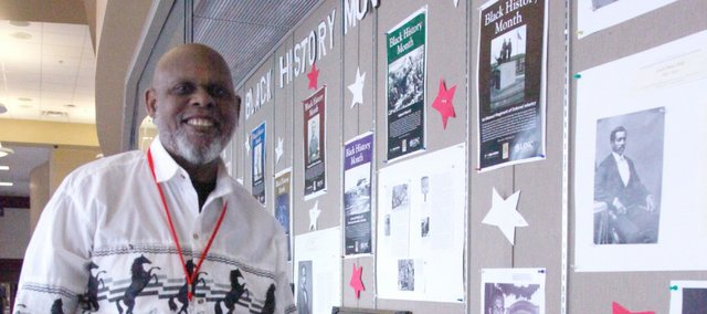 Lou Johnson stands next to his Black History Month exhibit near the Tonganoxie Performing Arts Center.