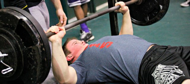 Seth Wolf set a meet record with a 305-pound bench press Saturday at Basehor-Linwood.