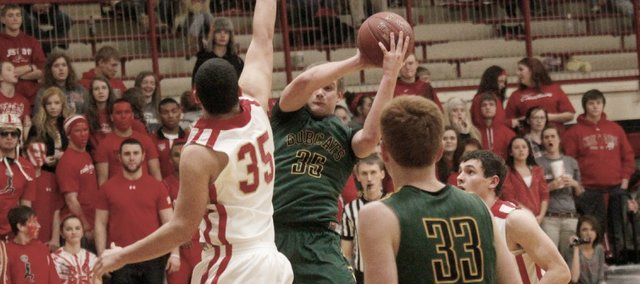 Chase Younger scored a team-high 20 points in a 77-69, double-overtime win Tuesday at Tonganoxie. The Bobcats also won Monday at Piper in double overtime.