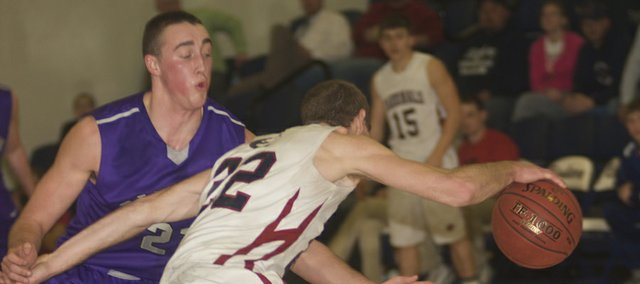 Baldwin senor Luke Fursman puts pressure on Eudora senior Andrew Ballock, in white, in the fourth quarter of the Bulldogs' 57-51 loss Tuesday to the Cardinals. Baldwin will try to get back in the win column Friday at De Soto.