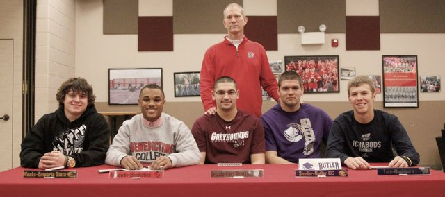 Five Tonganoxie High seniors have signed with college football programs across the state. Seated, from left, are Wyatt Weeks (Emporia State), Cole Holloway (Benedictine College), James Grizzle (Fort Scott Community College), Cody Snyder (Butler Community College) and Eric Tate (Washburn University).