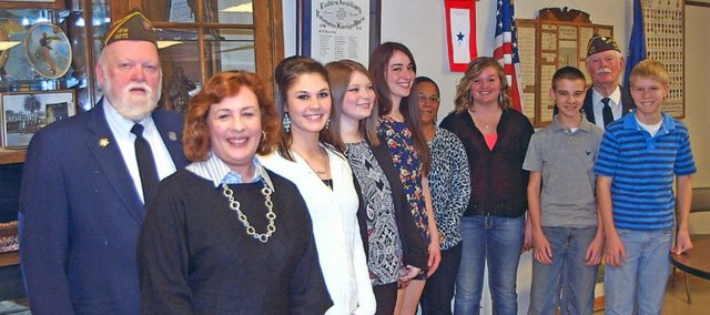 The Tonganoxie Veterans of Foreign Wars had a pizza party to recognize essay winners of the VFW's annual contests for high school and middle school. Pictured, from left, are VFW Commander Floyd Olson, THS teacher Kathy Nolan, Hadley DeHoff, Christian Grube, Grace Reilly, TMS teacher Debbie Holloway, Mariah Dohle, Blake Thoams, VFW essay coordinator Art Miller and Zeb Huseman.