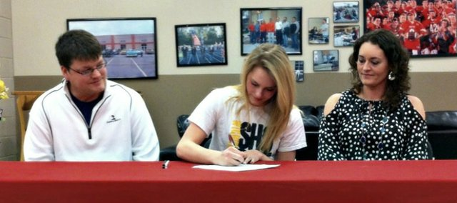Haley Griffin, center, will continue her high jump career next year at Wichita State University.