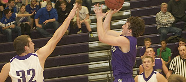 Baldwin senor Chad Berg goes into the lane late in the Bulldogs' 46-44 overtime victory Tuesday against Louisburg. Berg finished with a game-high 23 points in the game.