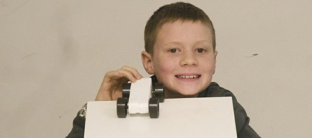 Baldwin sixth-grader Anthony Dunn won first place in the gravity car competition at Thursday Kansas University Engineering Expo with a Styrofoam car he designed, which was the lightest one entered. Five other Baldwin Junior High School enhanced learning students also won medals at the event.