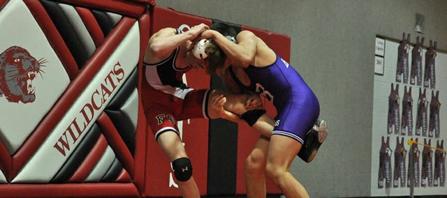 Baldwin sophomore Owen Tuckfield wrestles Fort Scott's John Hughes in the 160-pound semi-final match at the 4A state regional in Burlington. Tuckfield lost the match but was one of six Bulldog wrestlers, including five underclassmen, to qualify for the state meet this Friday and Saturday in Salina.