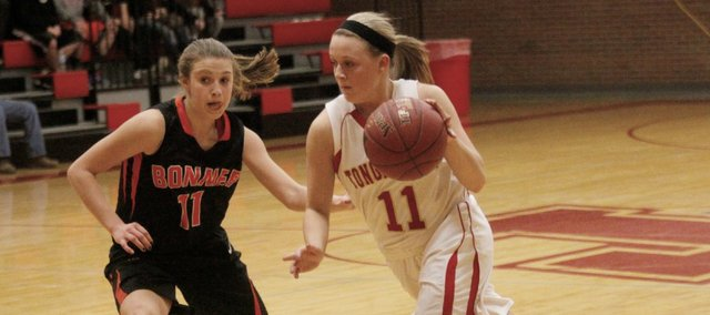 Tonganoxie's Emily Soetaert drives against Bonner Springs' Kennedy Bacon in Thursday's Kaw Valley League matchup at THS. The Chieftains defeated the Braves, 41-40.