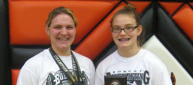 Kara Kollars, left, and Jamilee Malinowski earned Lifter of the Meet honors Saturday in Clay Center.