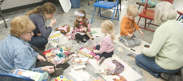 Baldwin City Public Library children's librarian Barbara Mathews, left, works on crafts with Wendy Southard and her daughter Leah, Henley Kaueffer, Lash Kueffer and Kay Payne during Wednesday's Storytime with Miss Barbara at the Lumberyard Arts Center.