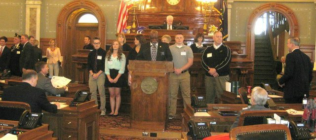 The Kansas Legislature honored the Basehor-Linwood powerlifting teams with a resolution before the House of Representatives on Wednesday in Topeka. Pictured, from left, are Eric Purrington, Sara Rehm, Allison Kasick, Rep. Willie Dove, Jay O'Bryan and assistant coach Tim Johnson.
