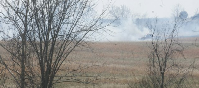 A fire truck fights a grass fire this afternoon in a pasture northeast of Vinland. Palmyra and Wakarusa township fire departments responded to the fire.
